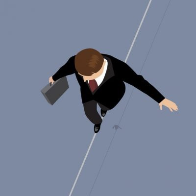 42852385 - business man on a wire. risk management concept